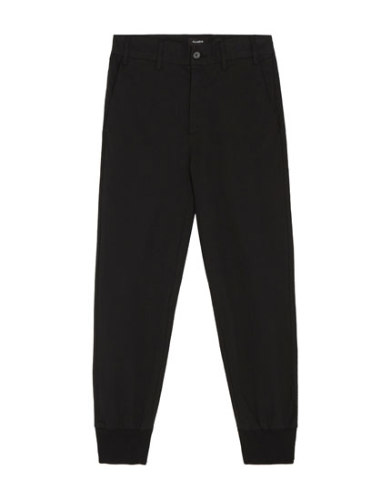 Tailored trousers with trimmed hems