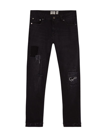 Skinny fit jeans met scheuren en patches
