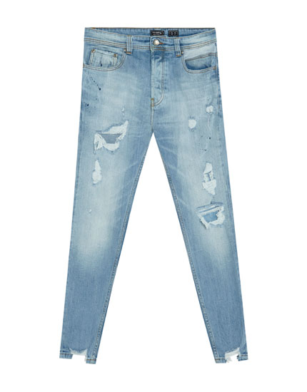 Jeans carrot fit con rotos