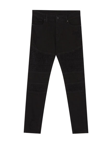Jeans carrot fit negros con rotos