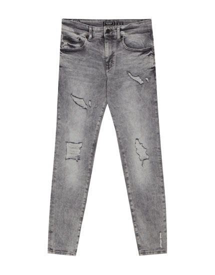 Dunkelgraue Skinny-Fit-Jeans mit Rissen