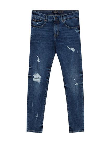 Dunkelblaue Skinny-Fit-Jeans mit Rissen
