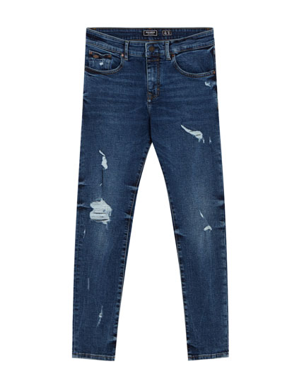 Jeans skinny fit azul oscuro con rotos