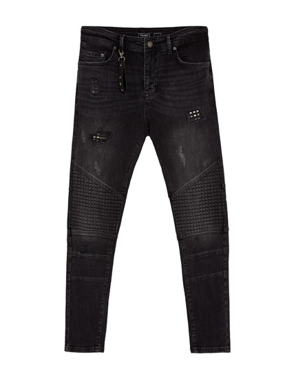 Jeans carrot fit biker tachuelas