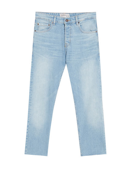 Medium wash blue jeans with frayed hems