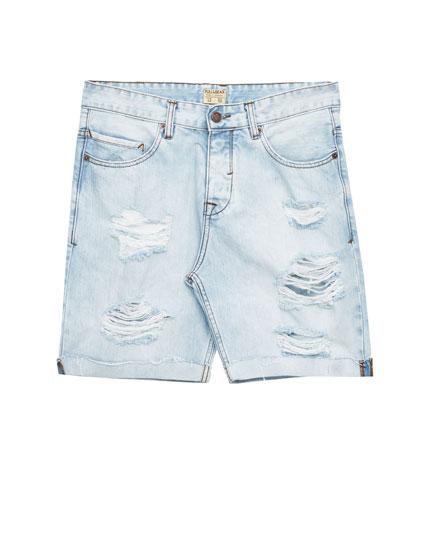 Slim-Fit Jeans-Bermudashorts.