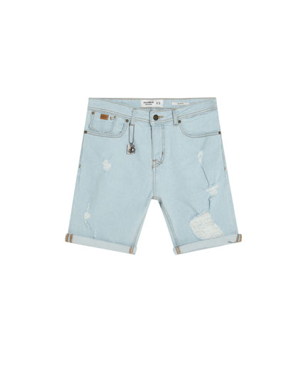 Slim comfort fit denim Bermuda shorts with rips