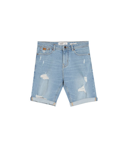 Slim fit comfort denim Bermuda shorts with rips