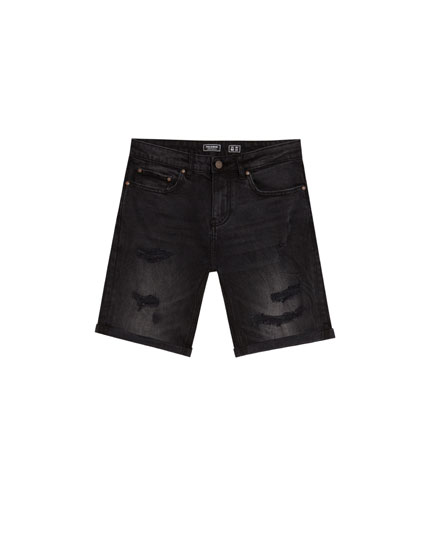 Slim fit black denim Bermuda shorts with ripped details