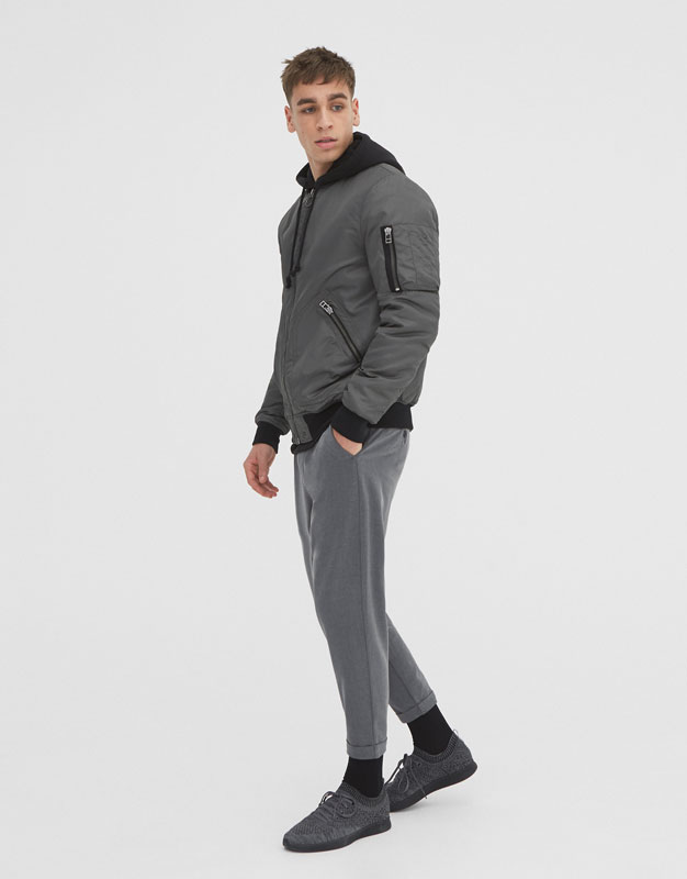 Bomber jacket with ribbed elastic trims