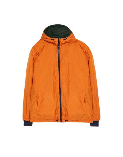 Reversible raincoat with hood