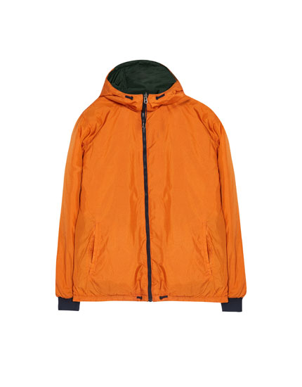 Reversible raincoat with hood