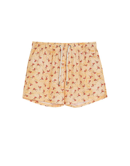 Flamingo print swimming trunks