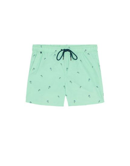 Swimming trunks with fish print