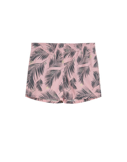 Pink swimming trunks with palm trees