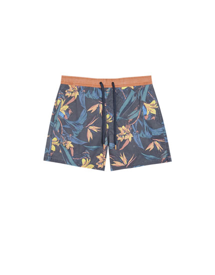 Floral swimming trunks with a contrasting waistband