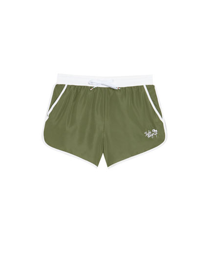 Short swimming trunks in several colours with trims