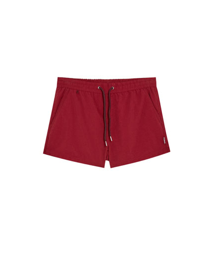 Plain short swimming trunks
