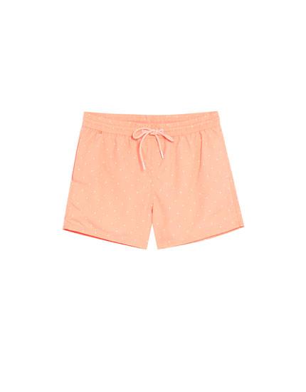 Orange swimsuit with stretch waist
