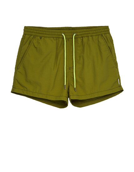 Basic coloured short swimming trunks.