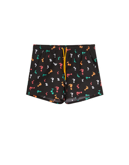 Short swimming trunks with palm tree print