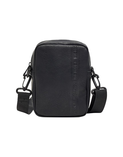 Small black faux leather backpack