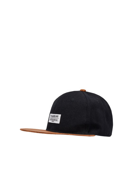 Cap with faux suede peak