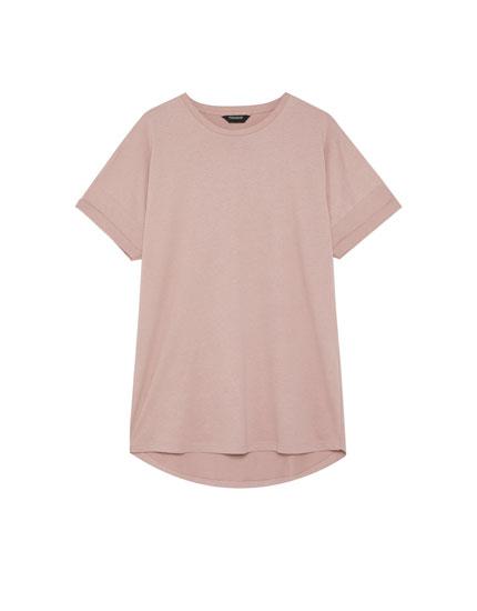 Camiseta long fit bajo desigual