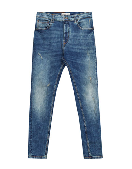 Carrot fit jeans met used effect