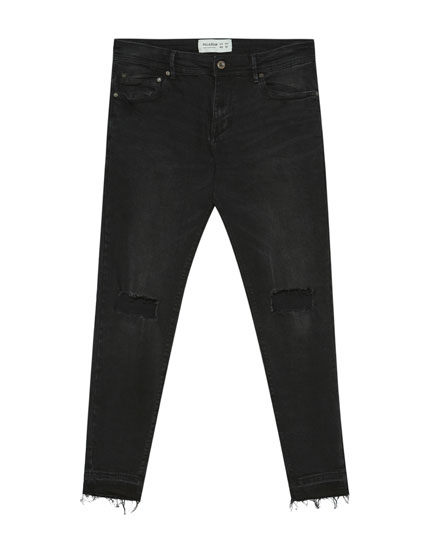 Jeans super skinny fit negro con rotos