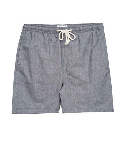 Bermuda corta elástico cintura.