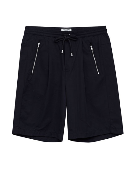 Black bermuda shorts with zipped pockets