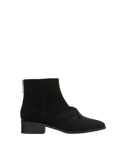Low heel ankle boots with knotted detail
