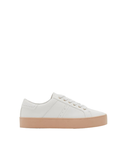 White sneakers with pink soles