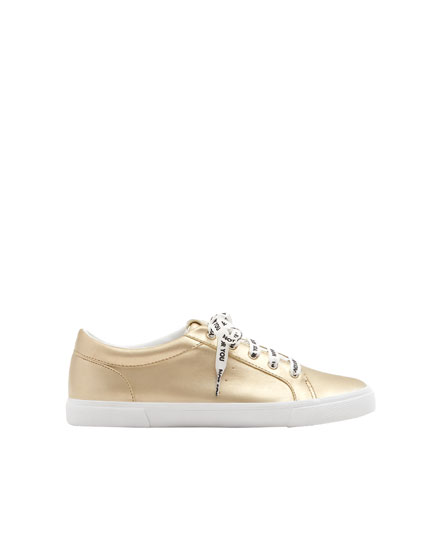 Metallic sneakers with slogan laces