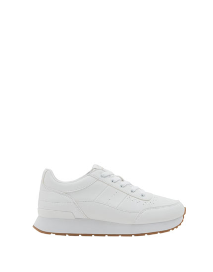 White urban jogging shoes with embossed detail
