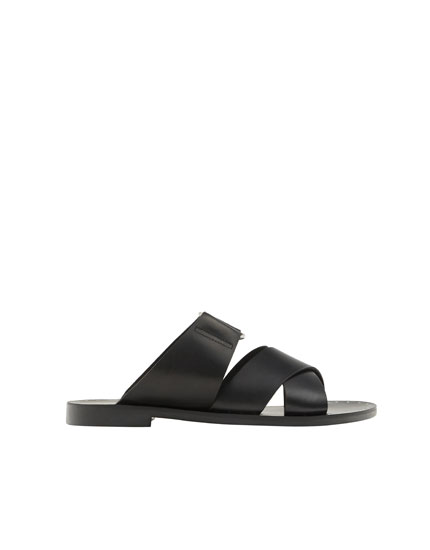 Black leather cross strap sandals