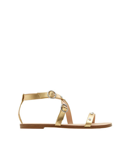 Golden sandals with details