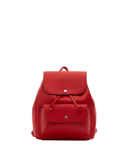 Red backpack with buttons detail