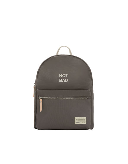 Dark grey fabric mini backpack with slogan