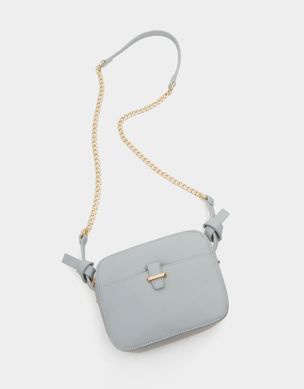 Mini blue crossbody bag with knot details