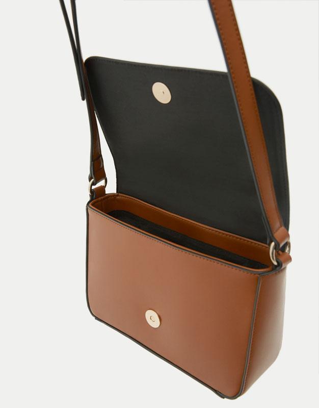 Mini crossbody bag with round clasp