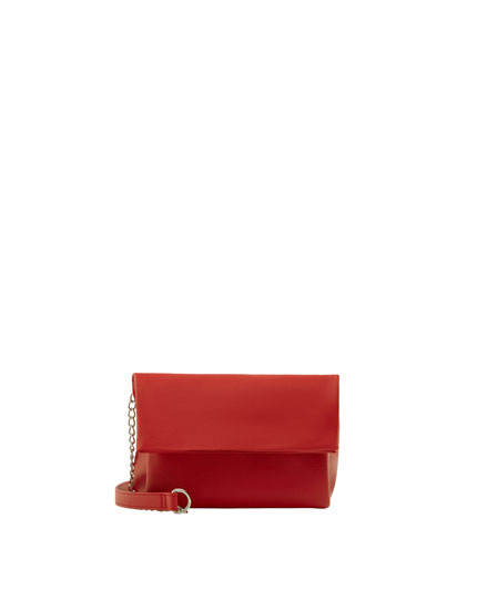 Red crossbody bag with flap and chain strap