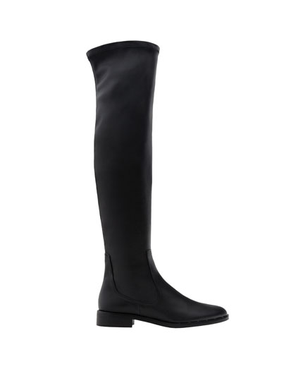 Flat over-the-knee boots with studded soles