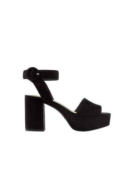 Black high-heel sandals with ankle strap