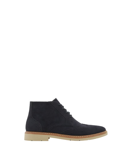 Navy blue brogue boots