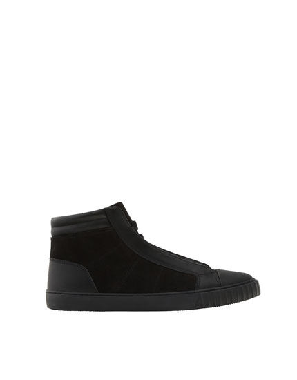 Black high top sneakers with toe caps