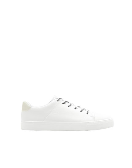 White sneakers with toe caps