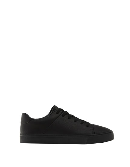 Black sneakers with toe cap