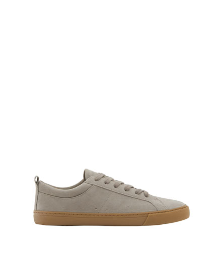 Grey sneakers with caramel-coloured soles